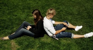 Finnish youngsters communicate by exchanging SMS messages in Kaivopuisto park
